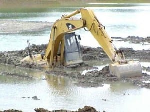 excavator caught in mud - rental insurance requirements