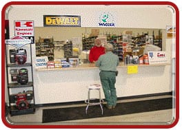 Picture of a customer at the parts counter buying replacement construction equipment parts